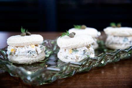 Chicken sandwich with garnitures and caesar sauce on glass plate Stok Fotoğraf
