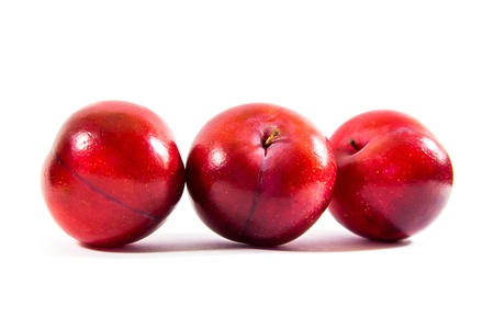 curren: three red apples