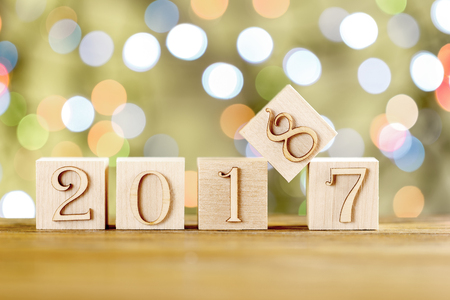 Congratulations to the New year. The new year 2018. Blurred light background. New year, replacing the old.