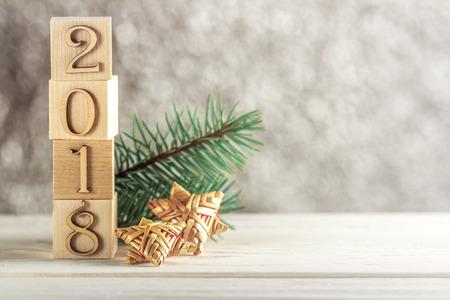 Kerstkaart. Blokken voor kinderen. Creatief idee. Het nieuwe jaar 2018. Plaats voor tekst. Stockfoto