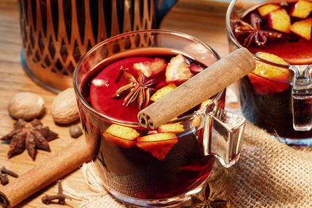 Energising and warming Mulled wine. Drink wine in cold weather. Two glass cups.