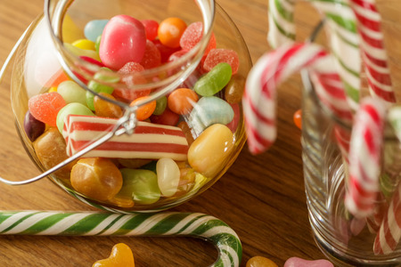 Bank with bright candy. The joy of children, a lot of sweets. Candy cane assorted colors.