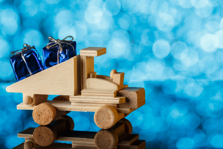 Delivery of gifts. Toy truck drives a little gift. Holiday card. A place for congratulations.