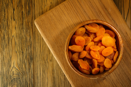 Dried apricots, place for lettering. wooden table, rustic style. Sun-dried fruit.
