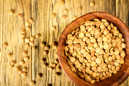 Lentils on the plate. Healthy diet. The family of legumes. Rustic style. Place for text. Stock Photo