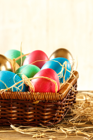 Happy Easter. Basket with Easter eggs on white background. Place for Text.