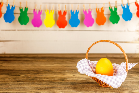 Easter card. Garland for Easter on wooden background, Easter egg. Happy Easter. Stock Photo