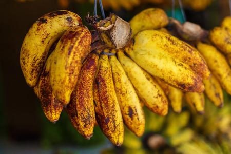 Bundles of bananas on the Asian market. Ripe, organic fruit.