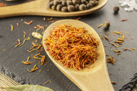 Dried saffron, seasoning. Kitchen mess, cooking. Fragrant natural spices.