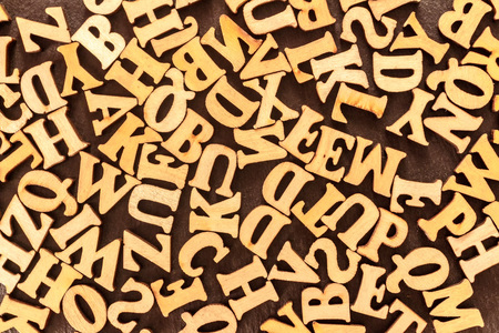 Wooden English letters background. The view from the top.