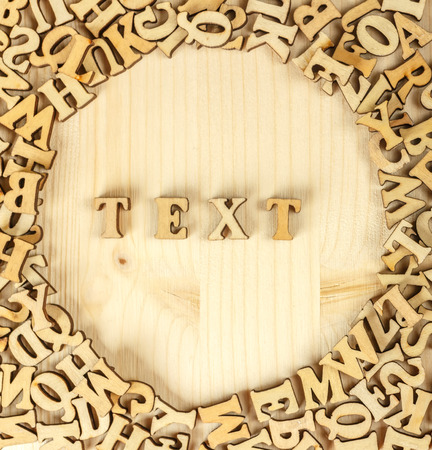 The inscription in wooden letters. From the letters make the text. The view from the top. Stock Photo