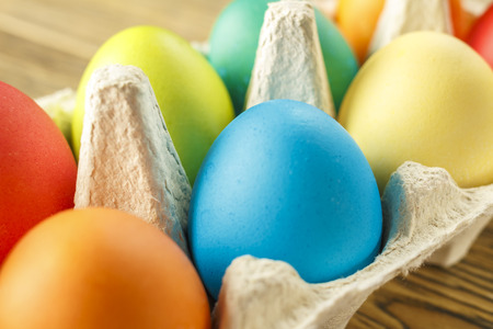 Bright Easter eggs in a special stand. Happy Easter. Close-up, blurred background. The texture of the shell.