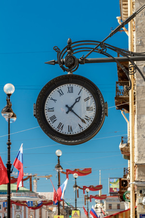 Round street clock. Russia St. Petersburg, Nevsky prospect. Stock Photo
