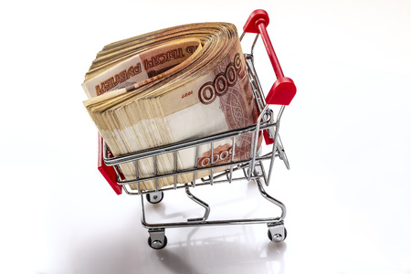 Truck with the money. A pack of Russian banknotes 5000 rubles. The moneys in the supermarket cart. Creative financing. Banking service. In isolation.Creative financing. Banking service. Фото со стока