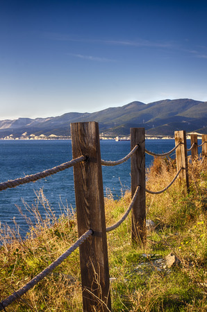 Seascape. Rope fence on the cliff. Perspective. Stok Fotoğraf