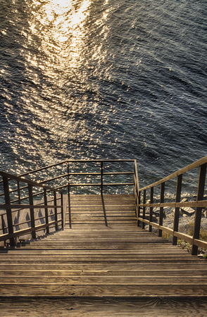 Wooden stairs, down to the sea. Seascape, blue sea. Stok Fotoğraf