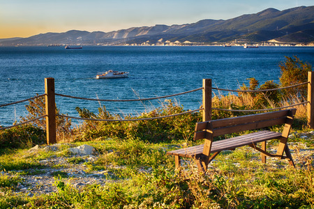 Bench by the sea. Waiting for the sunset on the cliff. A place of solitude.