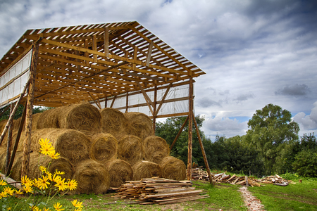 Countryside, hay for the winter. Barn with hay, sale price. Stok Fotoğraf