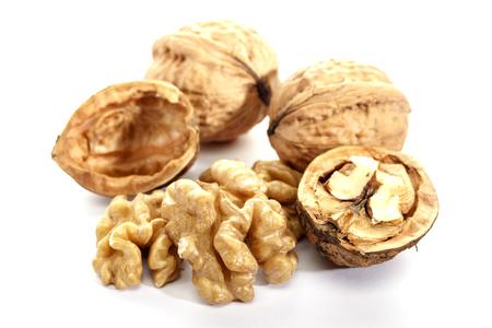 Walnut on white background, isolated. Cracked nut. Dietary product. Omega 3. Stock Photo