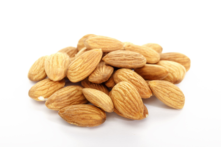 Almond on white background. Isolated objects. Nuts, natural product. Vegetable protein. Stok Fotoğraf