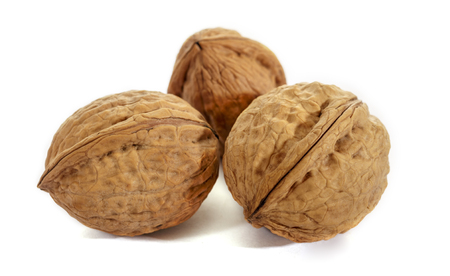Walnut on white background. Raw walnut. The texture of the shell.