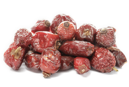 Dried berries of rose hips. Dried fruits. Dietary product.
