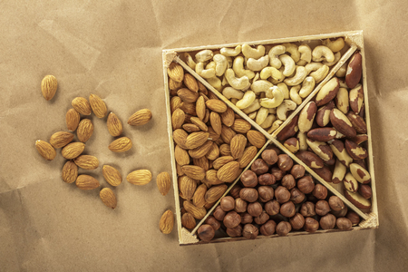 Assorted nuts. 4 types of nuts. Place for text. wrapping paper. Healthy natural food.