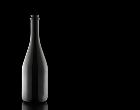 A bottle of champagne on a black background. A container of wine. Carbonated beverage. Festive alcohol. 写真素材