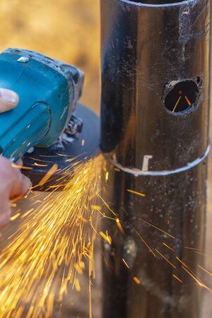Angle grinder, pipe end. Foundation works. Locksmith. 写真素材