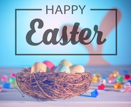 happy Easter. The Easter Bunny, a nest with eggs. Tinted effect. Blue background.