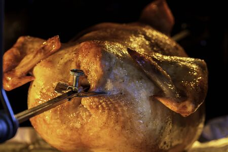 Grilled chicken in the oven. Roast poultry on a spit. Home cooking. Crisp. Natural product.