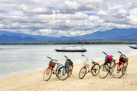 Low tide Island Indonesia. Gili Air 03.01.2017. View of Lombok Island. The main means of transportation on the island, a bicycle.