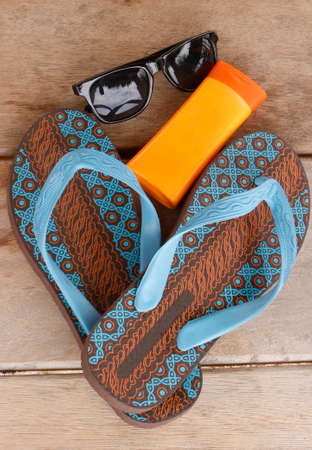 Beach kit. Protect your feet, skin, and eyes. Safety on a sunny beach on vacation.