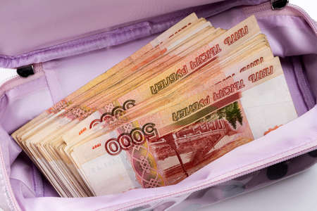 Women's cosmetic bag with a bundle of Russian money. Russian rubles with a nominal value of 5000. Criminal bribery.