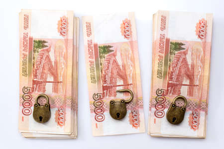 Wads of money under lock and key. Storage and control of financial savings. Russian money. 5000 rubles. A safe deposit box.
