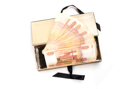 5000 rubles bills in the box. Money of the Russian Federation. Storage at home.