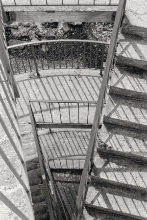 Descent to the beach. Imitation of a film photograph. Artificial noise. Black and white image. The golden ratio.