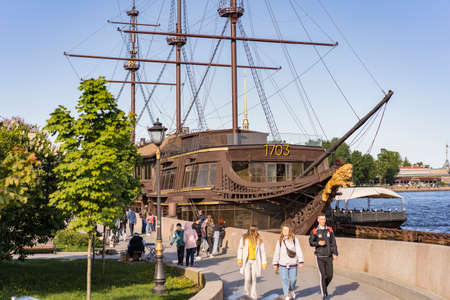 The Flying Dutchman restaurant. Frigate decoration of the city. Attraction on the Mytninskaya Embankment. Russia Saint Petersburg 29.05.2021 pm 19.00
