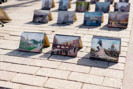 Sale of paintings in the city center of St. Petersburg, paintings on the sidewalk paving stones, flea market. Russia Saint Petersburg 29.05.2021 pm 16.48 Редакционное
