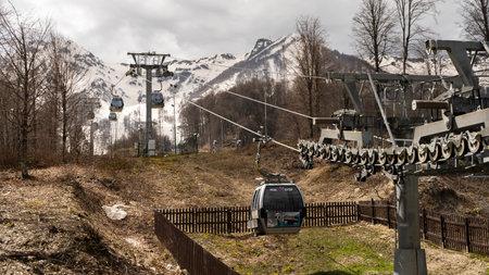 Krasnaya Polyana cable car / Gondola for climbing a mountain peak. Operation of lifting mechanisms. Security level. Russia Sochi Krasnaya Polyana. 04/28/2021 pm 14.22