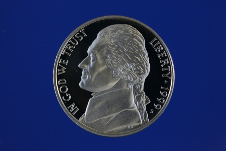 nickel: Jefferson nickel proof on blue background Stock Photo