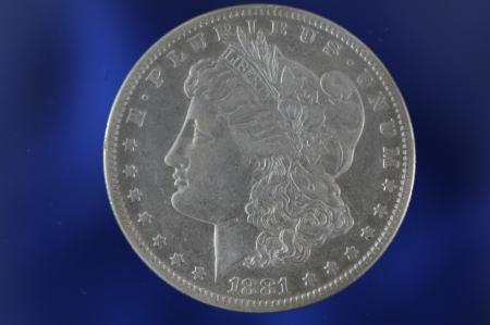 Morgan Silver Dollar on Blue Background Banco de Imagens