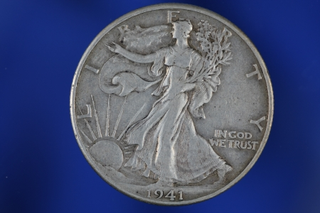 Walking Liberty Half Dollar on Blue Background