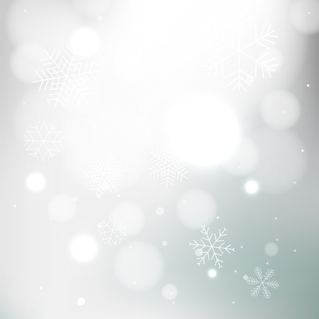 Gray winter background with snowflakes