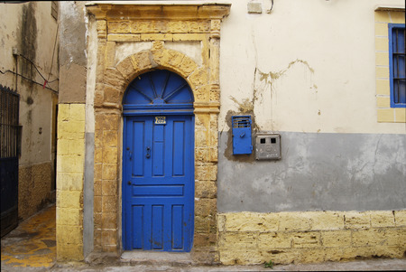 Classic moroccan style blue wooden door on the street of medina, Morocco, Essaouira Stock Photo