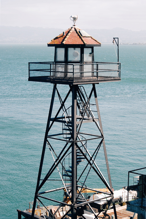 Watchtower on Alcatraz Island, San Francisco Bay, bright blue water