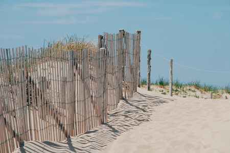 Wooden fence on the beach, Cape Cod, summer time