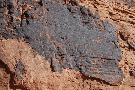 Petroglyphs on red sandstone in the Valley of Fire, Nevada, USA
