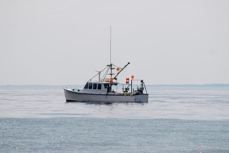 Small white boat in the ocean, Cape Cod