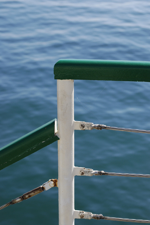 Hand rail on the pier with a blue sea on the back Stok Fotoğraf